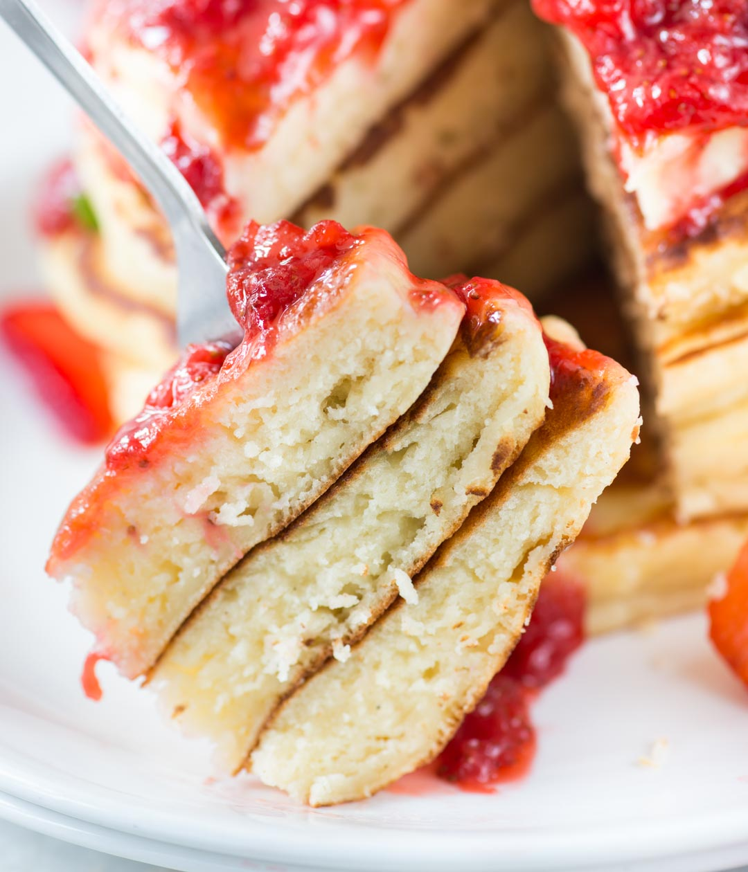 Ricotta Pancakes with Strawberry Sauce is super moist and fluffy. Perfect breakfast or for brunch.