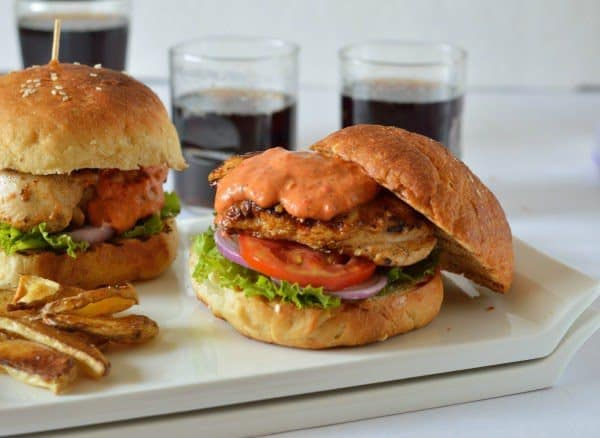 Chicken burger (honey wheat buns) with roasted tomato garlic mayo & oven roasted potato wedges