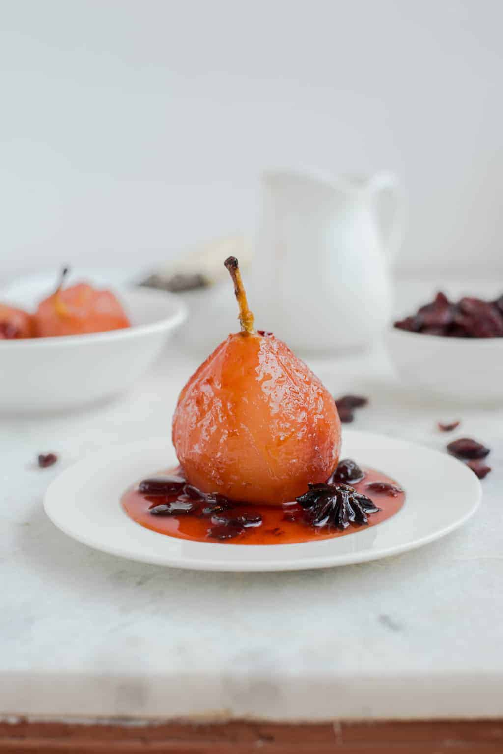 Pears poached in spiced cranberry juice recipe the for Spiced cranberry sauce with orange and star anise