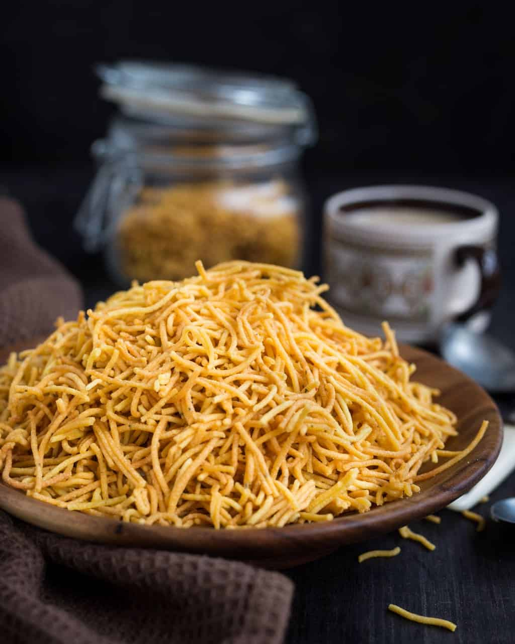 Crispy sev with an added twist of garlic and cheese in it. Perfect for munching or use as a topping.