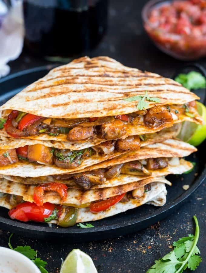 Veggie Quesadilla- These Mexican quesadillas are stuffed with caramelized pumpkins, mushroom, crunchy peppers, generously seasoned with spicy fajita seasoning and topped with cheese.