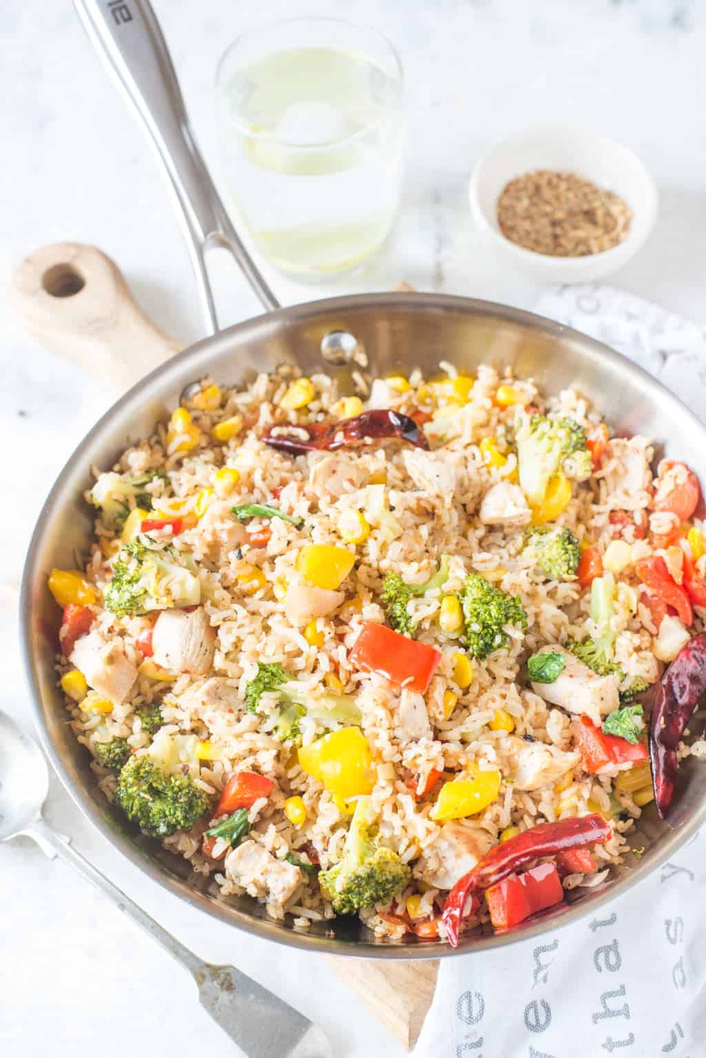 This Brown Rice Recipe with Chicken and vegetables is healthy, filling and easy to make. When made with leftover rice and precut vegetables, it would take less than 15 minutes.