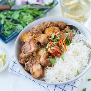 Lamb and potatoes cooked slowly in onion tomato gravy and Indian Spices. This basic Indian Mutton Curry with juicytender pieces of Mutton is perfect for a leisurely Sundayfamily meal.