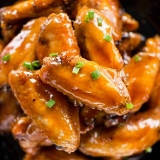 Crispy baked chicken wings are tossed in a sweet, sour and sticky sauce. These chicken wings are addictive and perfect party appetizer.