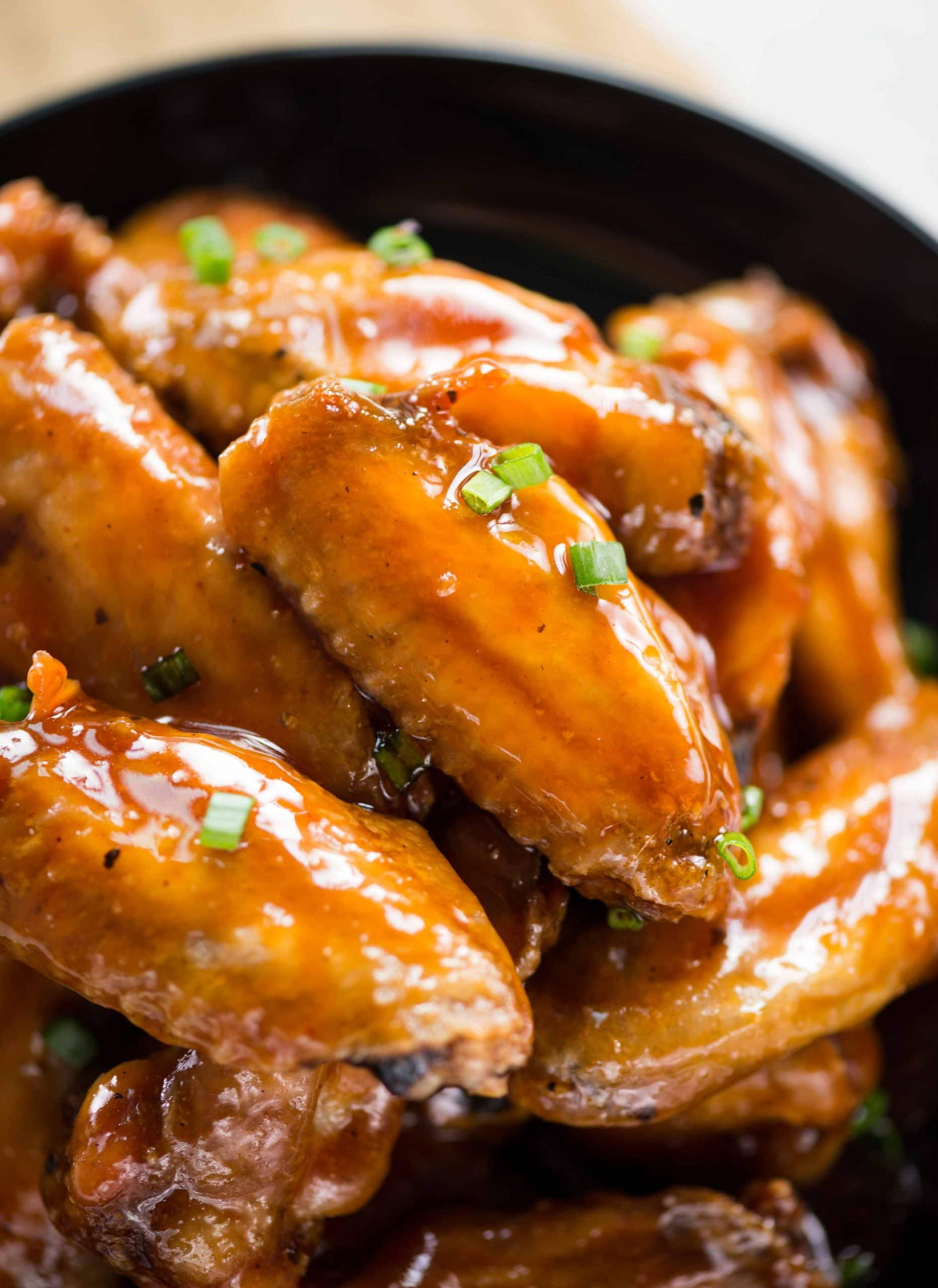 Oven baked Crispy Chicken wings tossed is a sweet and sour sticky sauce.