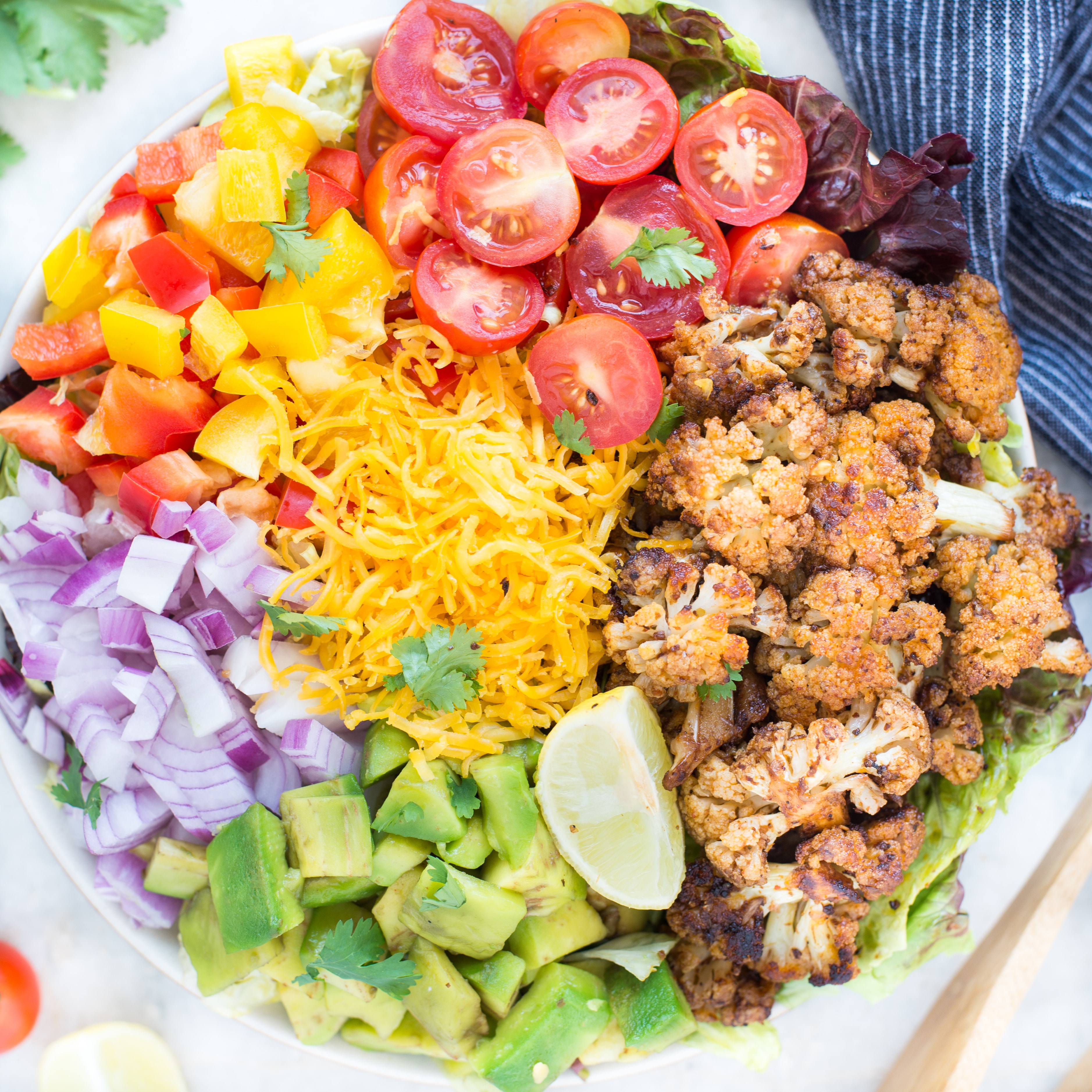 Healthy Taco Salad with Cauliflower is your answer for a low carb taco salad recipe. It is easy and comes together in 20 minutes. Perfect for a potluck.