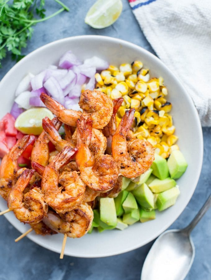 Grilled Shrimp with Corn Avocado Salad is a refreshing salad for warm summer days. Spicy grilled shrimp paired with grilled corn, avocado and other veggies takes only 15 minutes of your time.