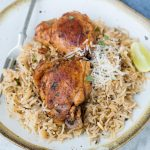 This Instant Pot Chicken and rice is a wholesome dinner that the entire family will love. Garlic Herb Chicken and Rice made in the Instant Pot have fluffy buttery rice and Juicy Chicken thighs.