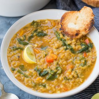 A comforting bowl of Spinach Lentil Soup made with Spinach, Red Lentil, Carrot and warm Spice is full of amazing flavours.  This red lentil soup is rich in protein, fibres and is gluten-free.