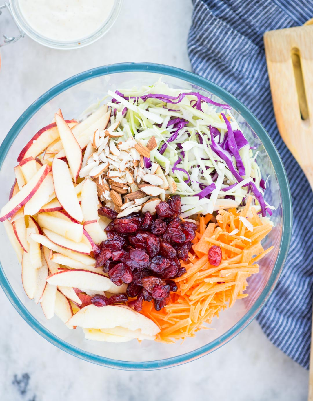 Crunchy apples, Cabbage, carrot, Tart Cranberries in a creamy dressing, this Apple Coleslaw or Apple Slaw is healthyand easy to make. A perfect side dish to serve and can be made in just 10 minutes.