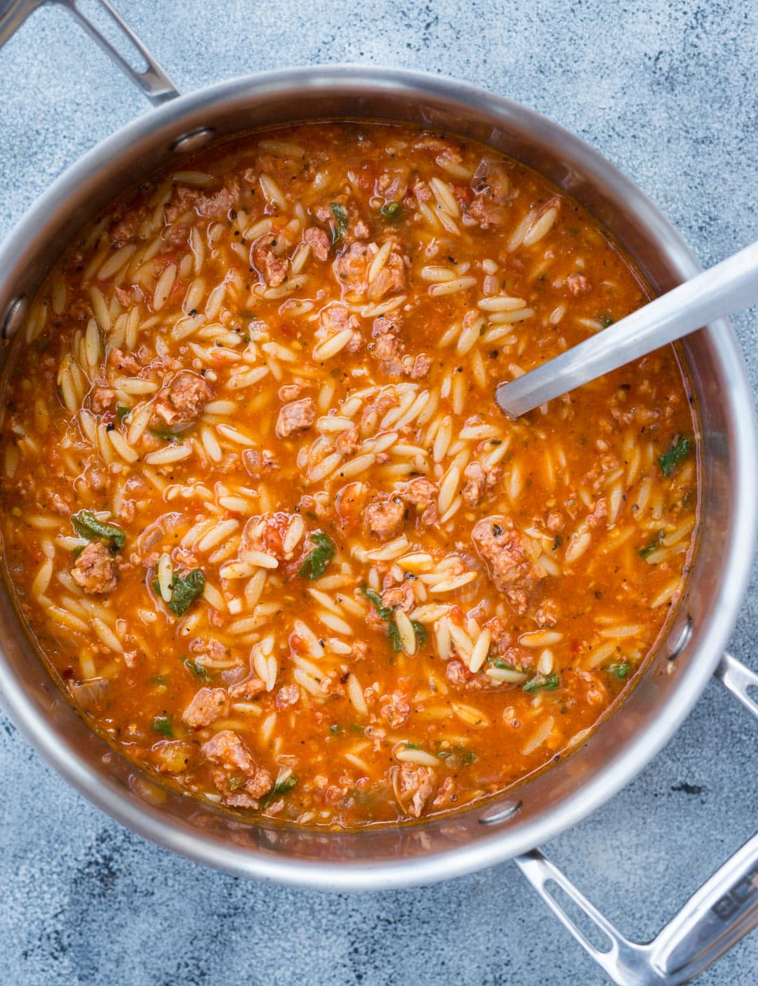 This Italian Sausage Soup with Spicy Italian Sausage, Orzo Pasta with rich tomato flavor is delicious and takes only 20 minutes to make.