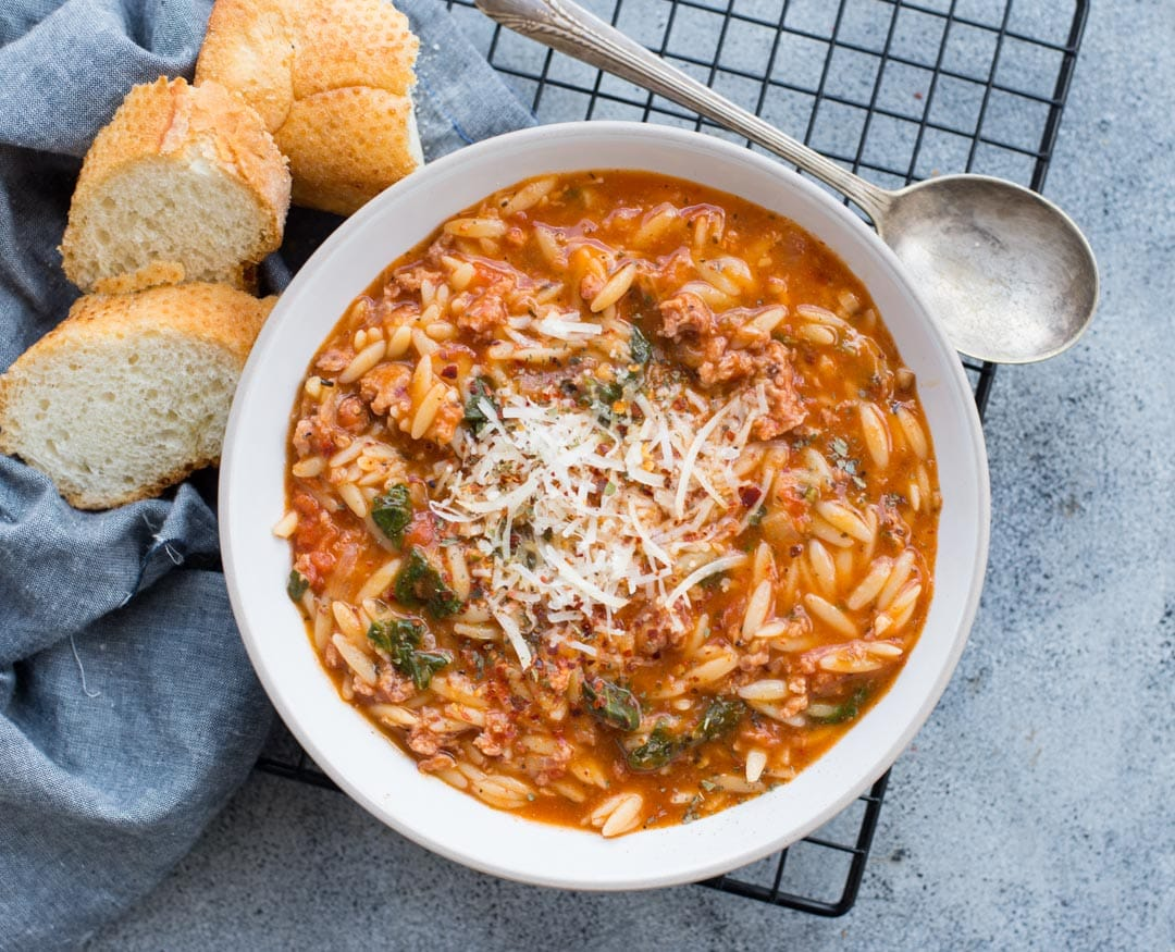 This One Pot Sausage and Orzo Soup with Spicy Italian Sausage, Orzo Pasta with rich tomato flavour is delicious and takes only 20 minutes to make.