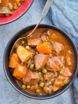 Slow Cooker Lamb Stew with tender fall apart lamb chunks and hearty vegetables have a rustic flavourful wine based gravy. This Lamb Stew is definitely going to keep you warm in the winter.