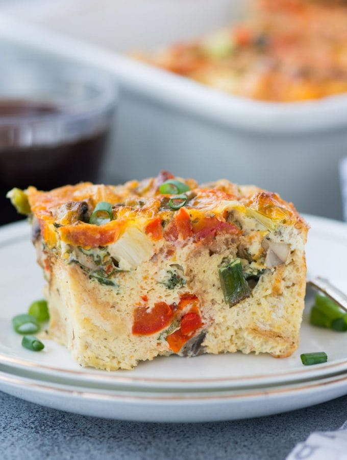 Easy breakfast casserole with bread loaded vegetables, egg, bread and topped with cheese. This Breakfast Casserole recipe can be made ahead and perfect to feed a big crowd.