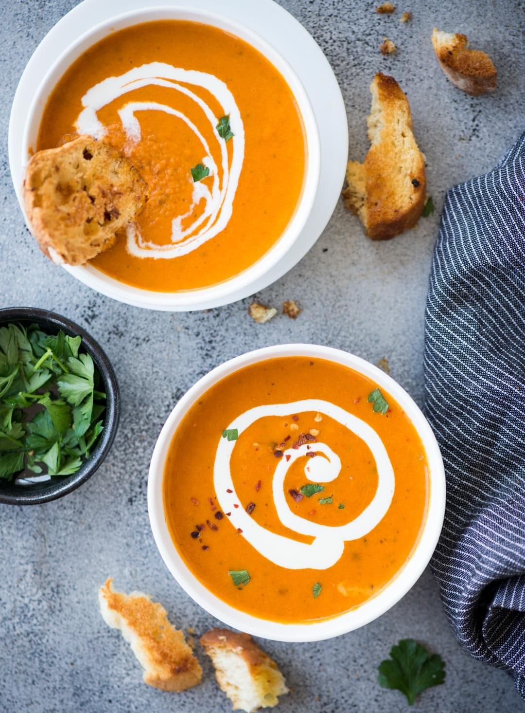 Thick and Creamy Tomato Bisque with a hint of tartness from the tomatoes, is the perfect soup for cold winter days. It is healthy, gluten-free and easy to make. Serve this with a big slice of crusty garlic cheese toast or grilled cheese.
