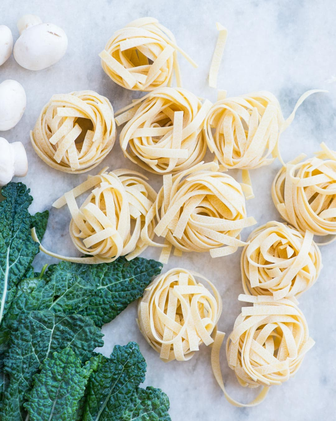 Lemon Garlic Kale Pasta. Pasta, Kale, Mushroom, peas tossed in a buttery lemon garlic sauce and topped with Parmesan. This one-pan delicious dinner is easy and quick to make