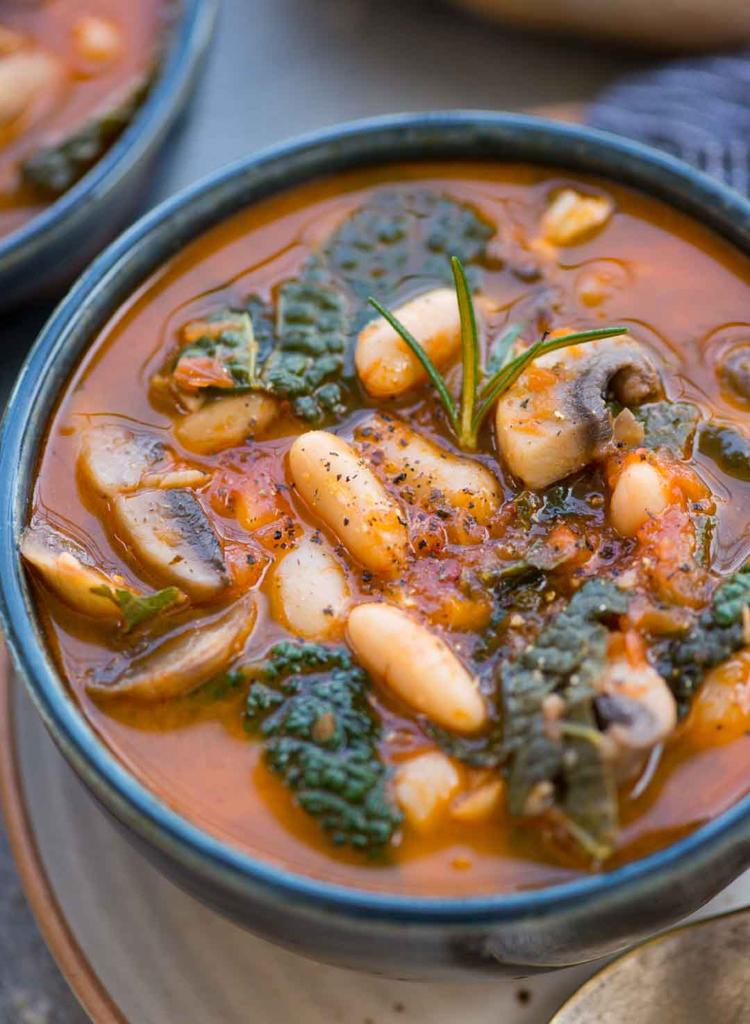 This White Bean Soup with Mushroom and Kale in Tomato based broth is so hearty and delicious. You need only one pot and 20 minutes to make this Soup. Also vegan and gluten-free.