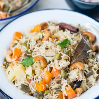 Veg Pualois an Indian style rice pilaf made with long grain basmati rice, an array of vegetables and whole spices. This fragrant one-pot dish can be made on stove top, in a pressure cooker or in an Instant Pot.