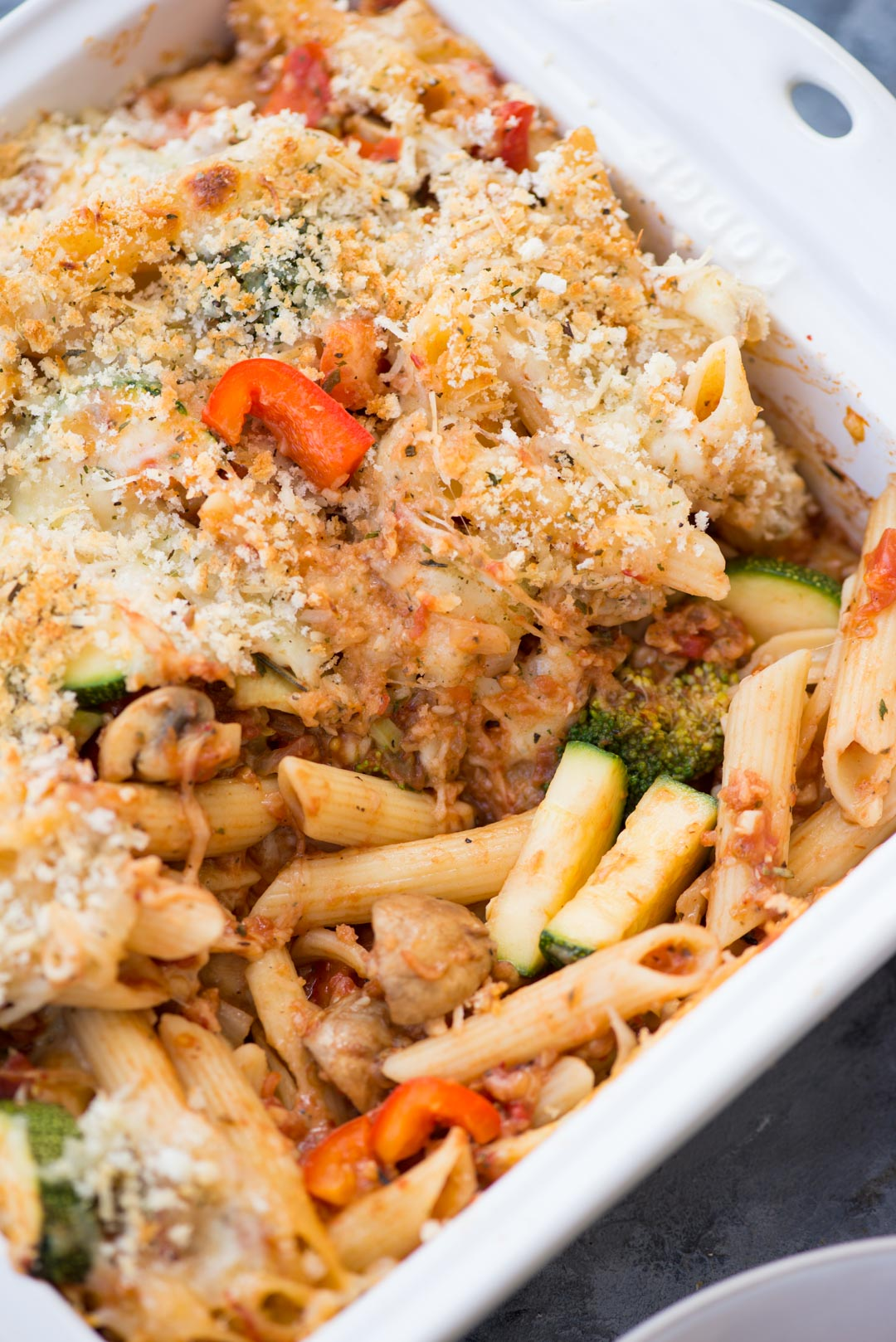 This Easy Vegetable Pasta bake is loaded with Vegetables, has a Chessy Sauce and takes less than 30 minutes to make. A perfect weeknight meal or to serve a crowd.