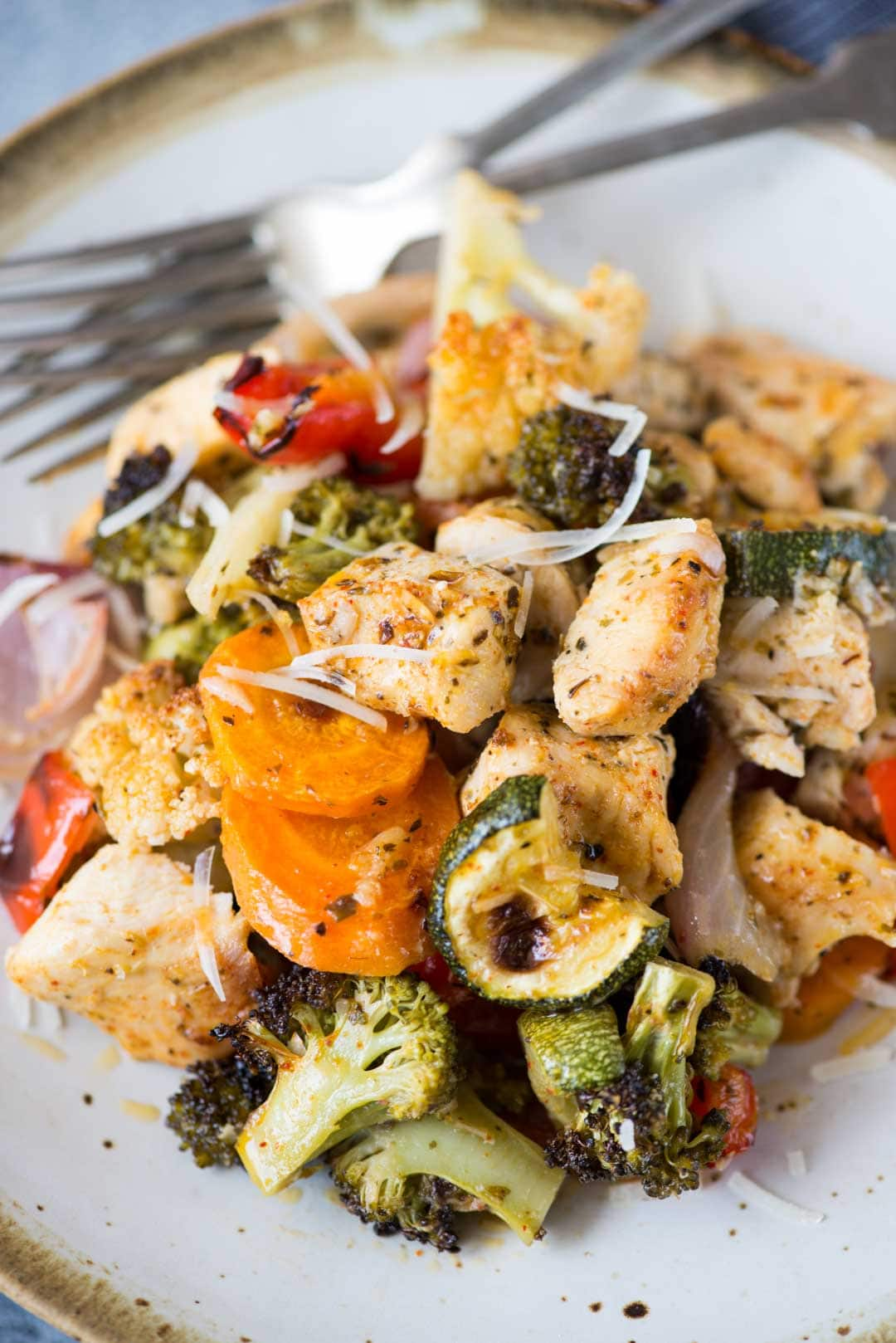 Oven Roasted Vegetables with Chicken is vegetables, chicken tossed in butter, Italian seasoning and roasted until charred and tender. Roasted vegetables are super easy to make and healthy too.
