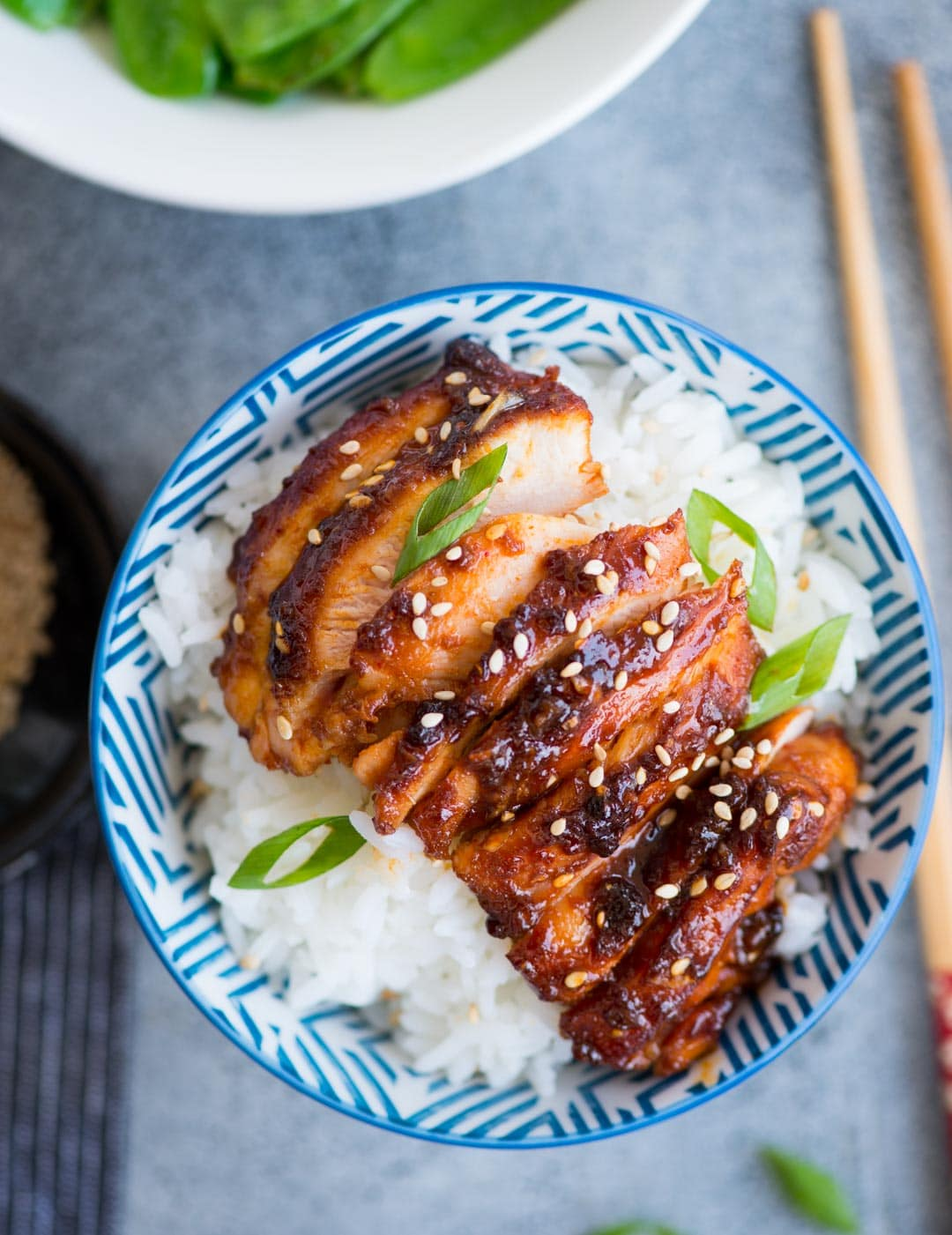 Sticky Korean Chicken made with Gochujang, soy sauce based marinade is bold in flavours and really easy to make. Chicken thighs coated in a sweet and spicy sauce and cooked until juicy.