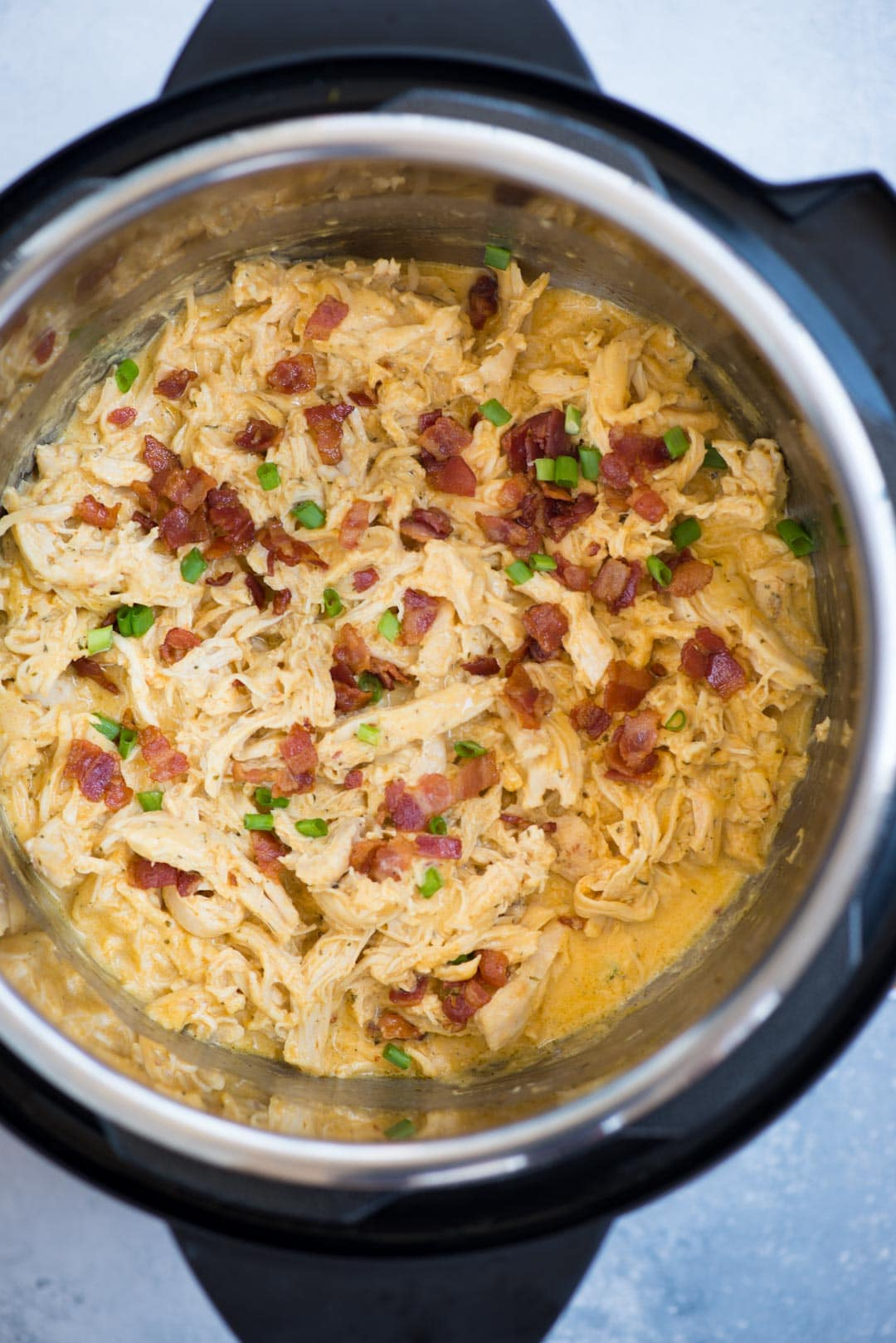 Instant Pot Crack chicken made with Chicken, Ranch Seasoning, cream cheese, Cheddar cheese and crispy bacon is incredibly delicious. This low carb, Keto chicken takes only 10 minutes to make.
