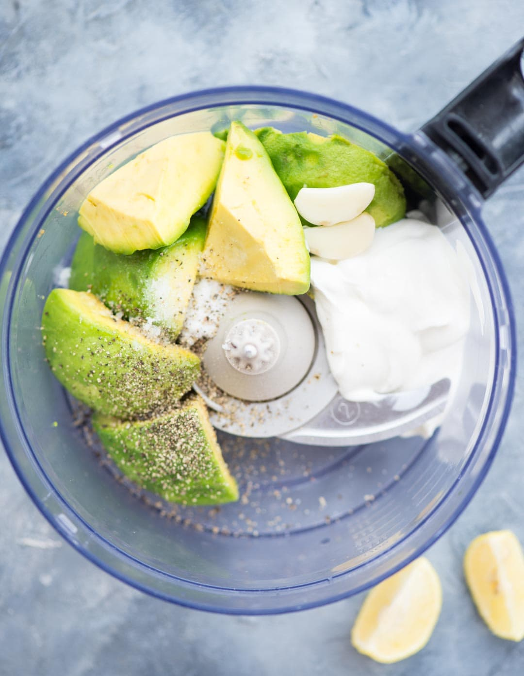 Creamy Avocado Dip made with Avocado, Sour cream, garlic, Lemon Juice is a perfect dip for Nachos, Pita and veggies. Make this for a quick snack or at your next party to impress your guests.
