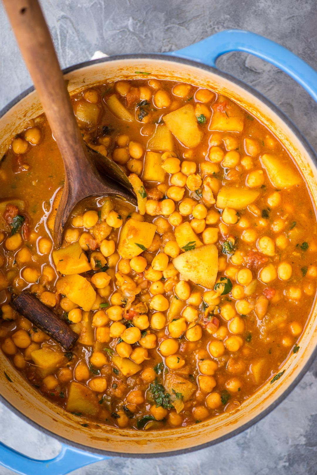 Chickpea curry with potato or Chana Aloo packed with Indian flavours, nutritious and needs less than 30 minutes to make. This vegan chickpea curry is best served with rice or naan.