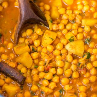 Chickpea curry with potato or Chana Aloo packed with Indian flavours, nutritious and needs less than 30 minutes to make. This one pot chickpea curry is best served with rice or naan.
