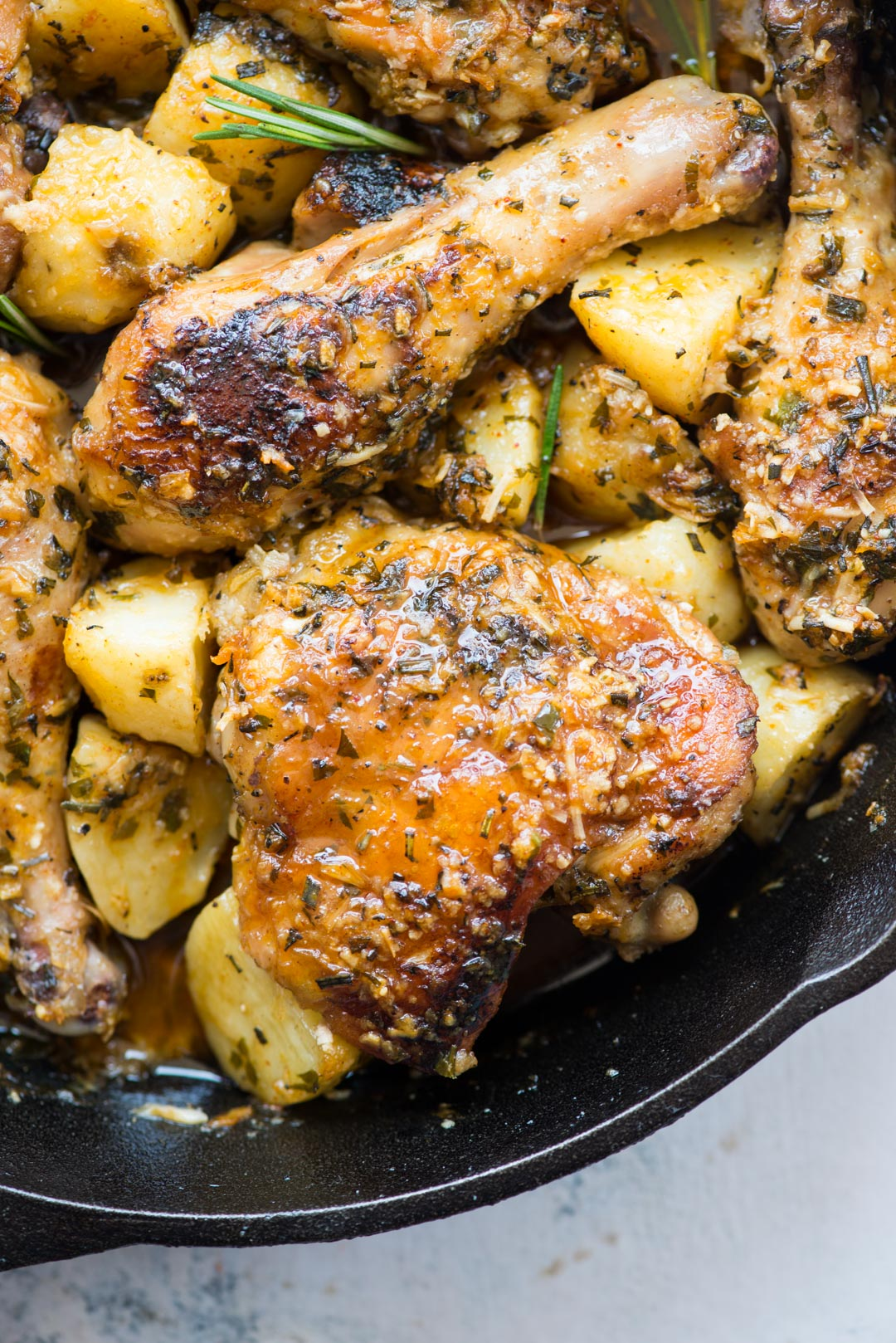Baked chicken and potatoes in a butter garlic herb sauce, crispy garlic parmesan crusted chicken is a delicious one-pan dinner and very easy to prepare.