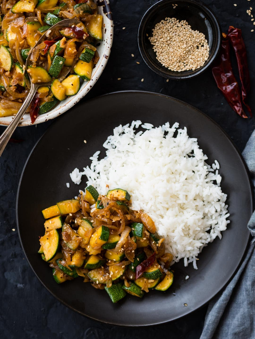 This flavour-packed Zucchini Stir Fry gets ready in 15 mins. Make this super quick stir fry with Onion, Garlic, Zucchini tossed in a simple sauce.