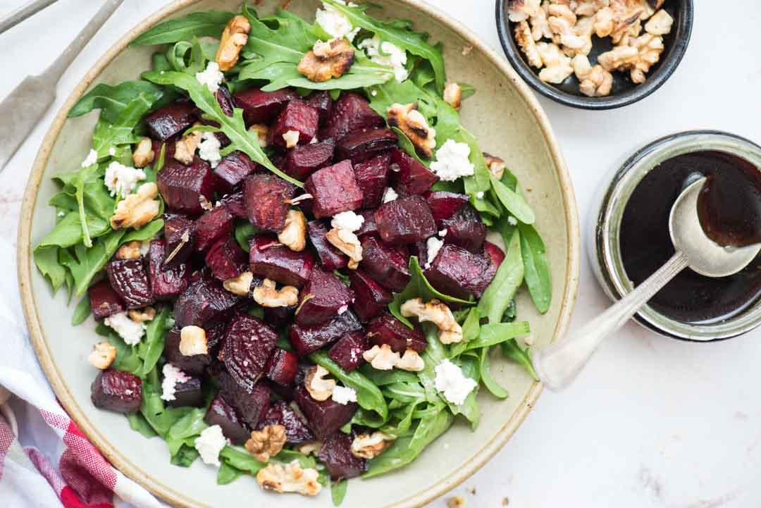 Arugula salad with roasted beetroots, fresh arugula leaves, goat cheese, walnut and a delicious balsamic dressing. It is easy to put together and is a perfect side dish to go with dinner.