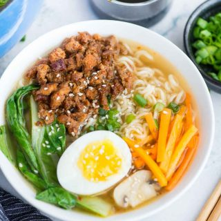Spicy Pork Ramen takes less than 20 minutes to make. A really flavourful broth with a secret ingredient for extra depth of flavour, ramen noodles, spicy pork is comfort in a bowl, especially for cold winter days.