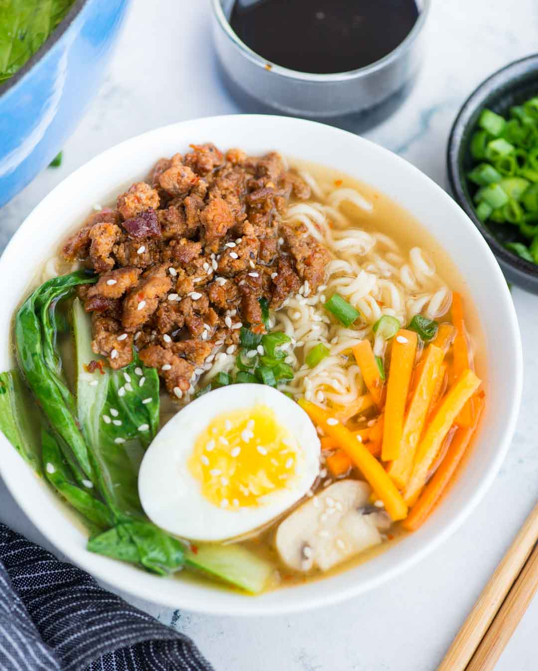 This Ramen recipe takes less than 20 minutes to make. Pork ramen with a really flavourful broth with a secret ingredient for extra depth of flavor, ramen noodles, spicy pork is comfort in a bowl, especially for cold winter days.