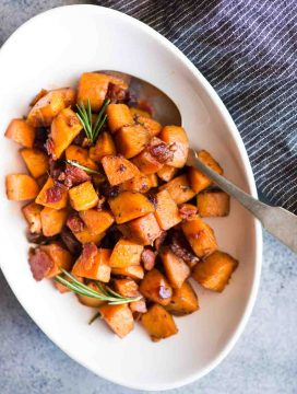 Maple Bacon Sweet Potato Hash with a hint of cinnamon and rosemary is easy to make. A perfect side dish to serve with your dinner or thanksgiving dinner.