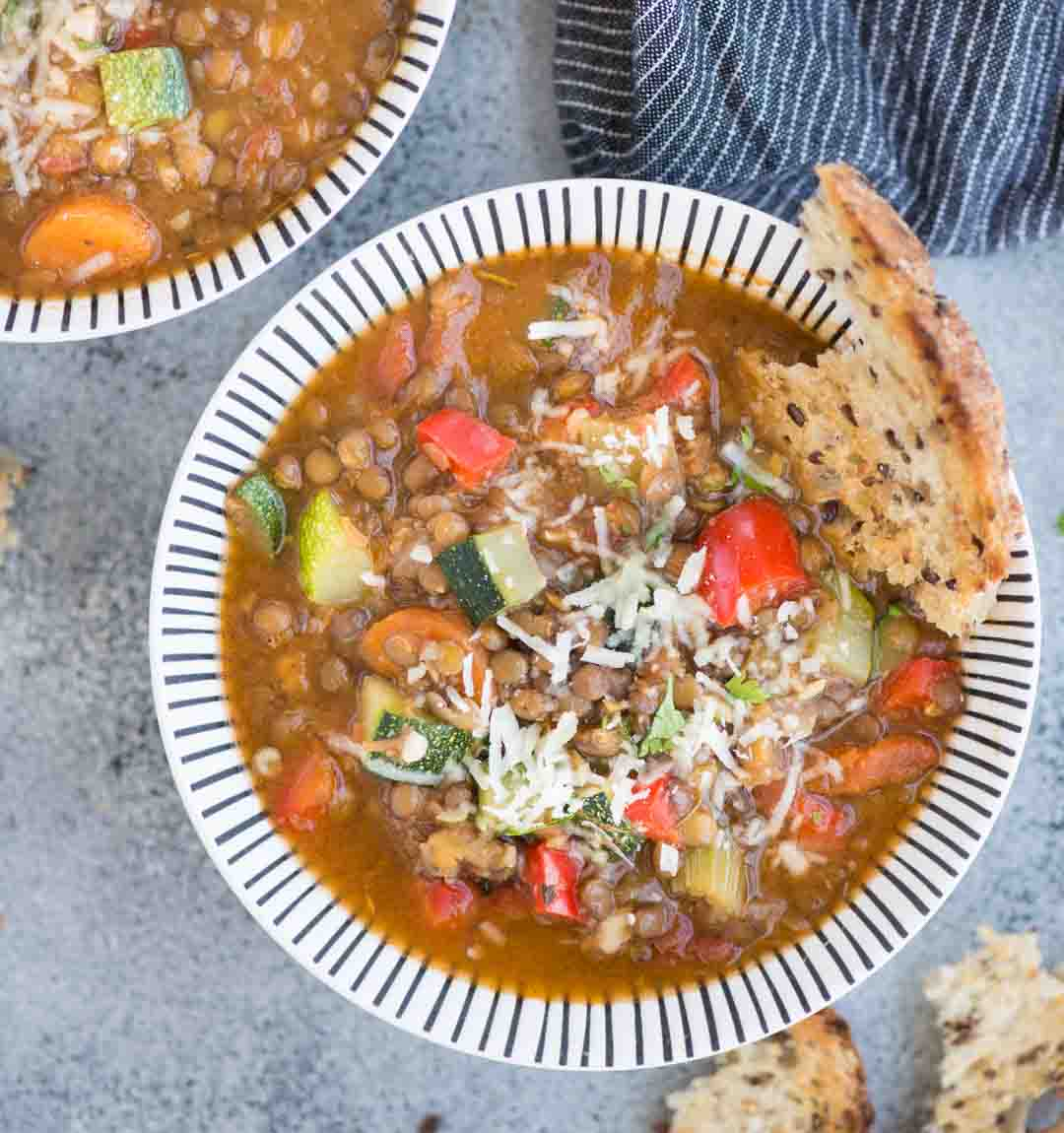 Vegetable Lentil Soup with array load of vegetables is a filling one-pot vegan meal. Made with Lentils, Zucchini, Carrot, Celery, this soup is loaded with plant-based protein and fiber.