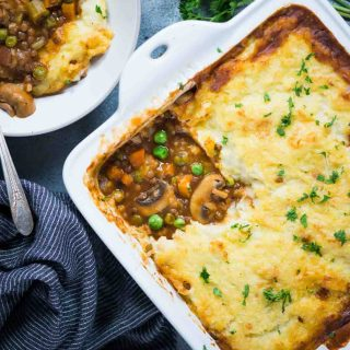Warm and cosy Vegetarian Shepherd's Pie made from Lentils and vegetables, a flavourful wine-based gravy and then topped with a creamy layer of mashed potato.
