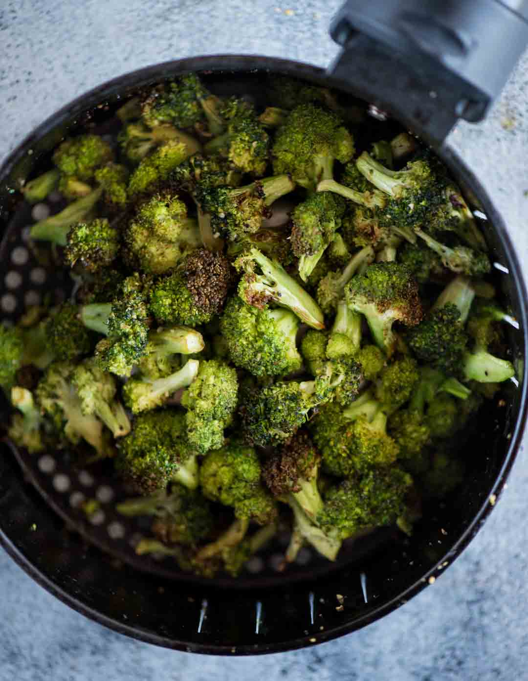 Broccoli florets are tossed in oil, garlic, salt, pepper and lemon juice and roasted in an air fryer for about 10 minutes. One of the best-roasted broccoli I would say.