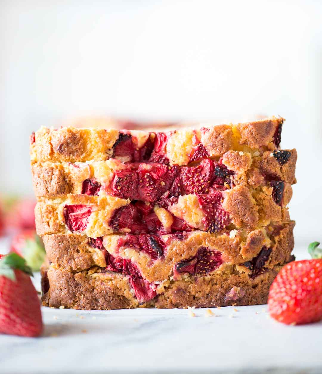 Strawberry Cake with loads of fresh strawberries is made from scratch with basic pantry staples. You will get to taste strawberry in every bite of this buttery, moist and delicious cake.