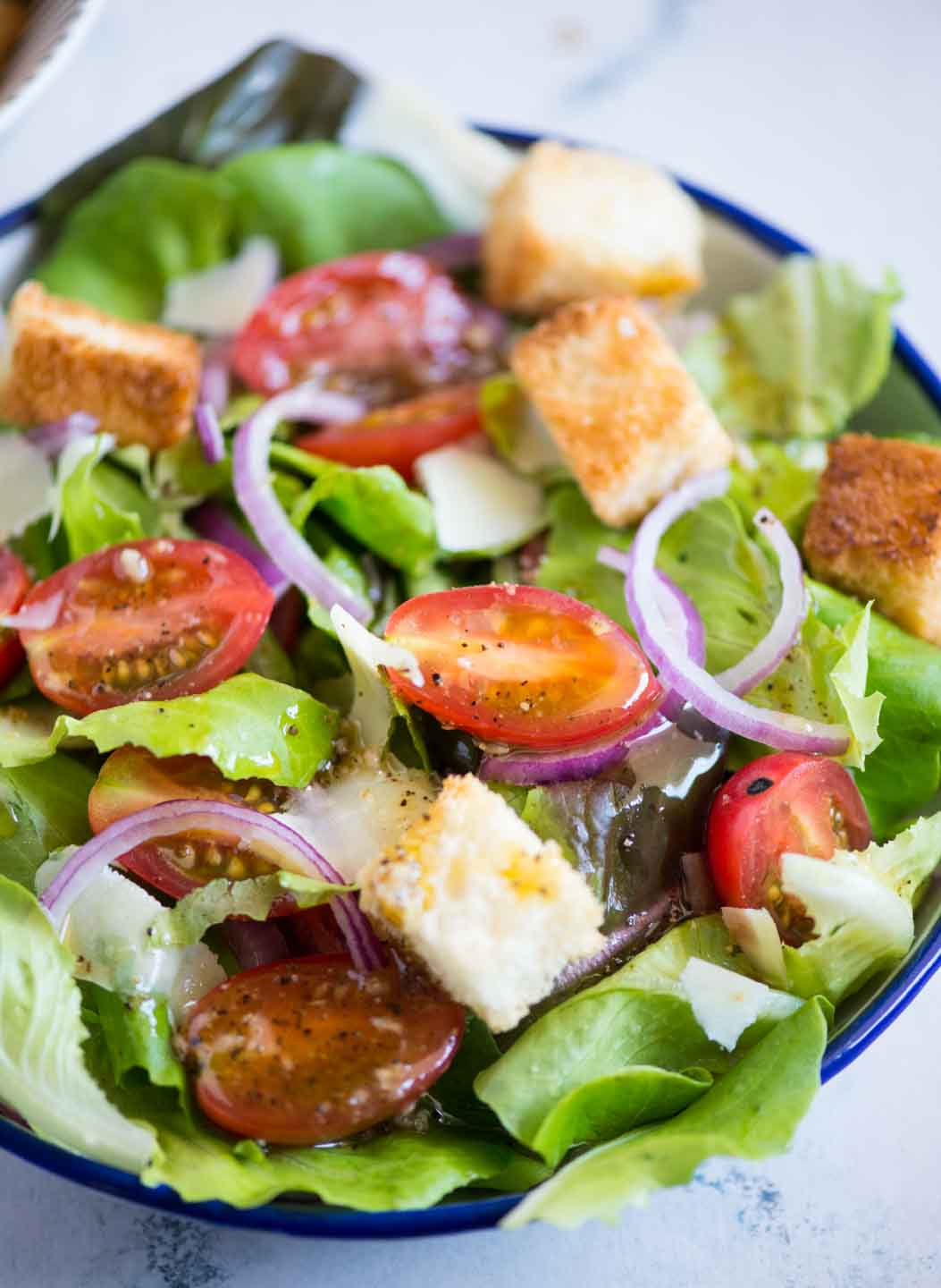 There is something so satisfying about this Italian Chopped Salad. Fresh greens, Tomatoes, Onions tossed in a light vinaigrette. A Simple salad that you can serve with any meal.