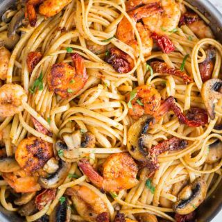 Mushroom Garlic Shrimp Pasta in a mildly spiced buttery sauce is light and loaded with flavour. Caramelized mushrooms, Juicy shrimps, Sundried tomatoes, all these goodness in one pan, makes it a perfect meal on any occasion.