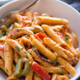 Chicken Fajita Pasta is a one-pot dinner that takes 30 minutes to make. Creamy pasta with chicken, peppers, onion and fajita seasoning, you would fall in love with this easy pasta recipe.