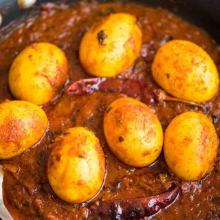 Egg Curry is a deliciously rich onion tomato gravy, tastes exactly like the ones you get in dhabas. These are perfect with some rice or paratha and fresh salad on the side.