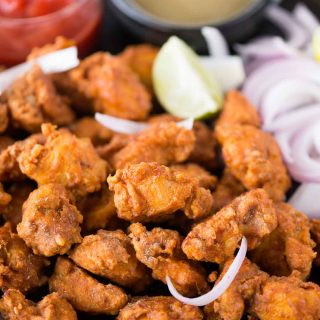 Seriously addictive Chicken pakora is a crowd pleasure in any party. Chicken coated in a thick spicy batter, fried until crispy and tastes exactly like street style.