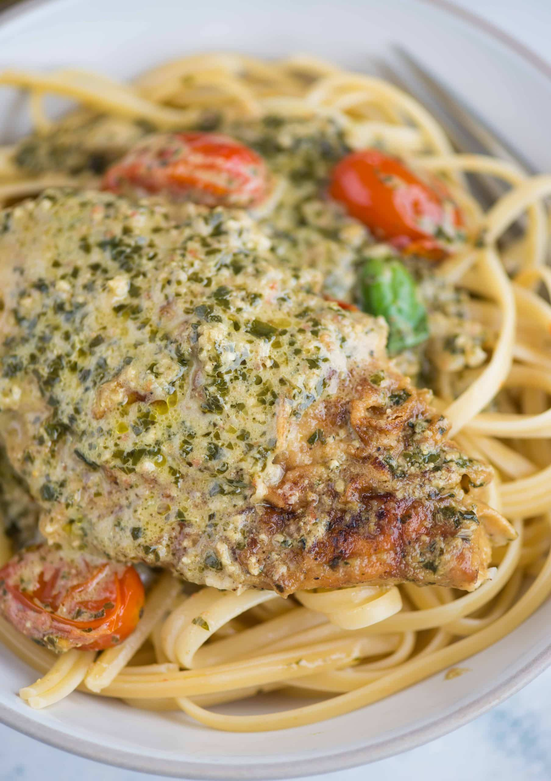 Pesto Chicken in a light and creamy sauce is packed with flavor that takes less than 30 minutes to make. Toss some pasta in the sauce and a delicious dinner is on the table in no time.