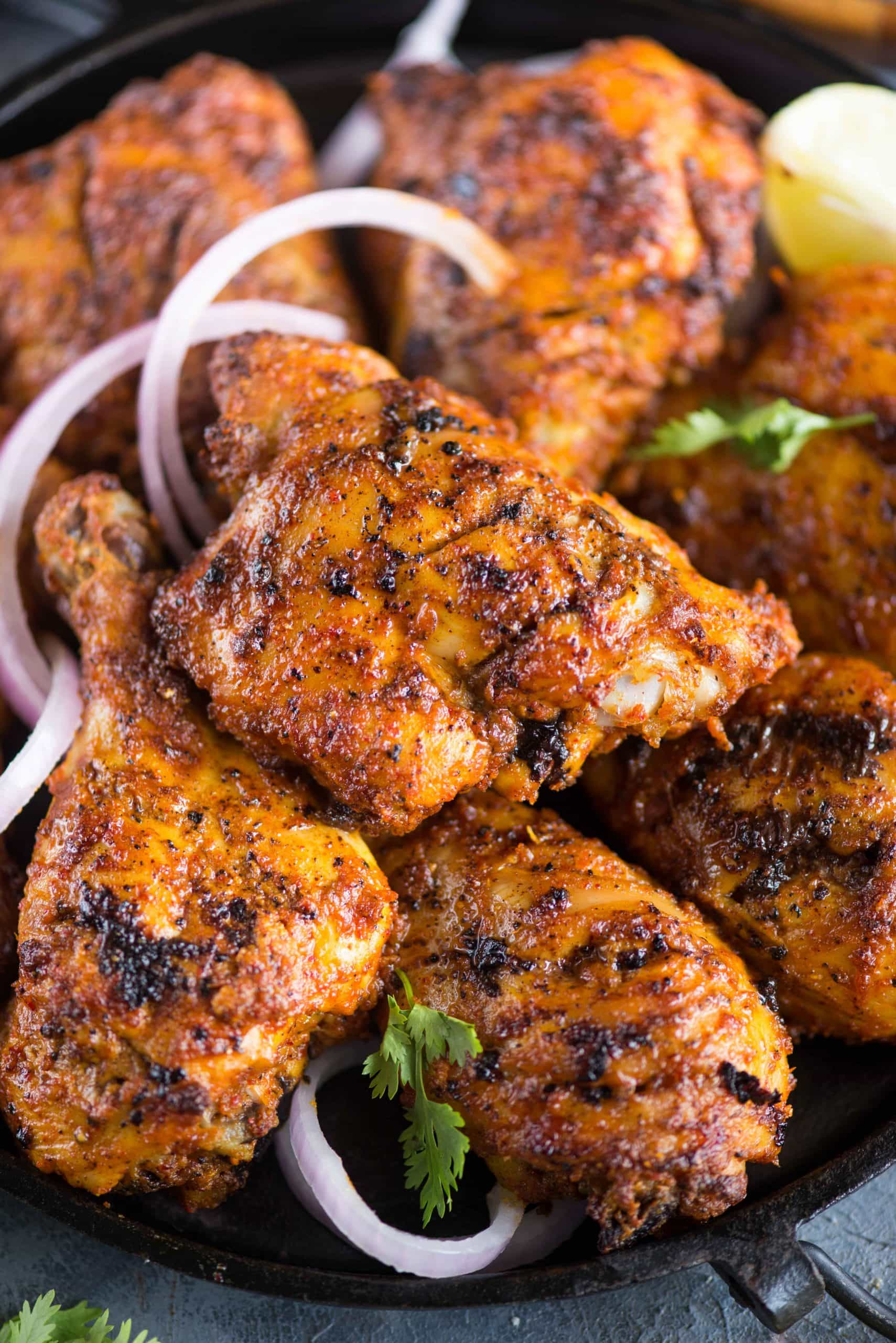 Smoky and juicy Tandoori Chicken gets its flavour from the Yogurt, ginger garlic paste and spice marination. It can be made on the grill, oven or Stovetop.