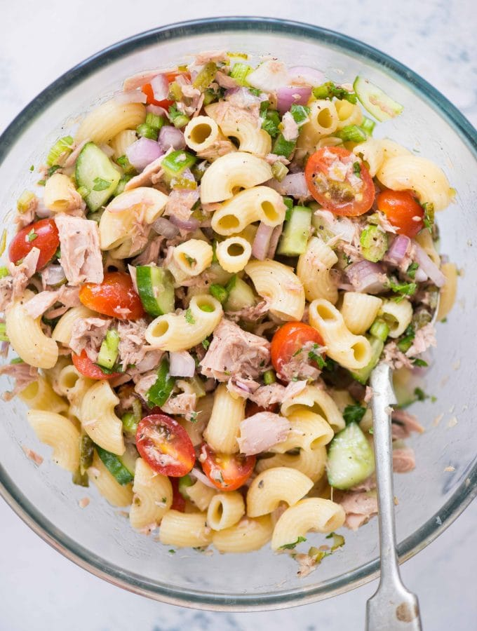An easy 15 minutes Tuna Pasta salad recipe that is light and healthy with the goodness of tuna, macaroni, veggies, and olive oil. Perfect cold salad to serve during summer.