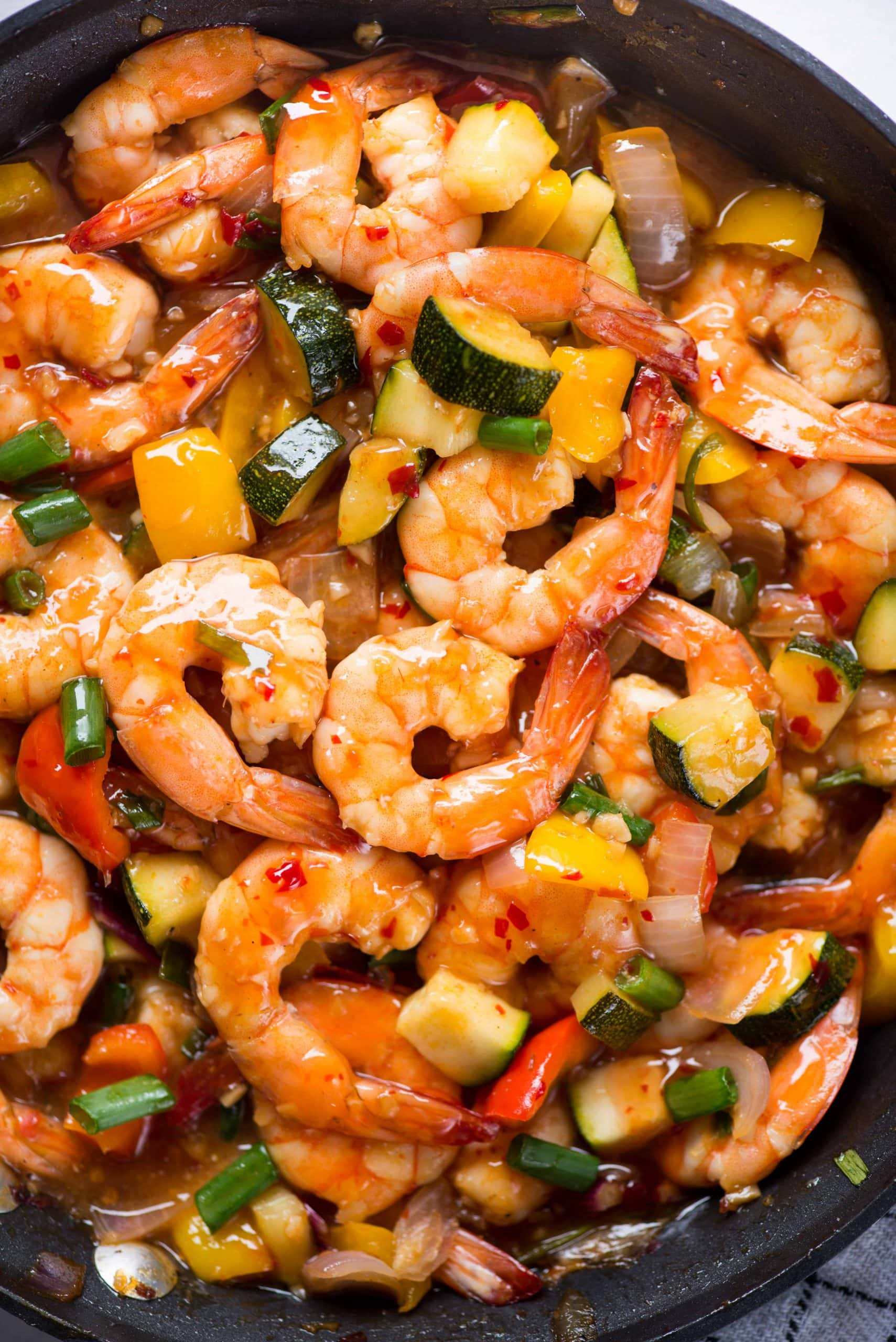 Quick and easy Shrimp stir fry with zucchini, pepper, and tossed in Thai Sweet chili Sauce. An easy 15-minute dish to serve with your favorite rice or noodles.