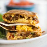 Crispy Tortilla filled with soft scrambled eggs, cheese, breakfast sausage, and bacon, Breakfast quesadilla is easy and quick to make. These quesadillas are perfect for breakfast, brunch, or even dinner.