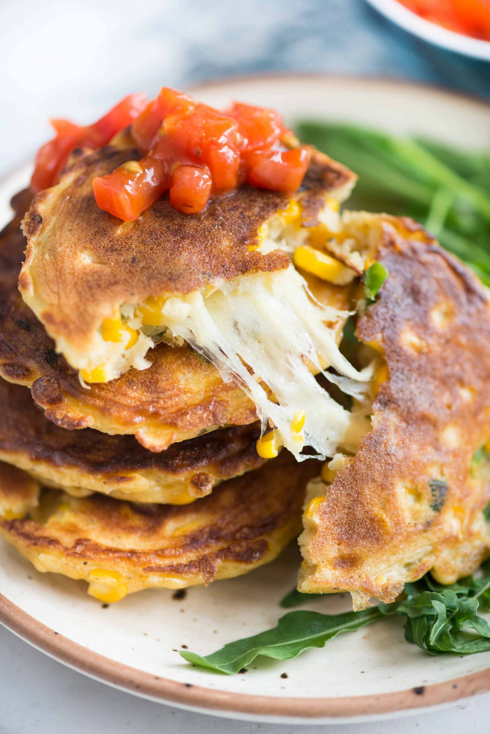 These crispy Corn Fritters are loaded with fresh summer corn, jalapenos, green onions have a gooey cheesy surprise in the middle. These delicious can be served as snacks or as a side dish along with your favorite dips on the side.